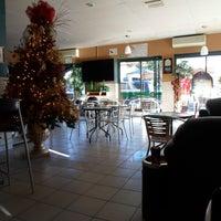 Photo taken at 5ta. Avenida Café by Tribillin F. on 12/24/2013