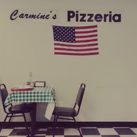 Photo taken at Carmine's Pizzeria by Brad K. on 4/21/2015
