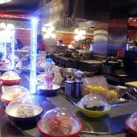 Photo taken at Yo! Sushi by Laura T. on 4/19/2013