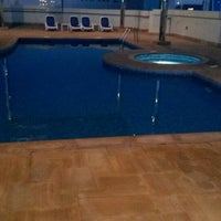 Photo taken at Pool @ Dubai Gate 1 by Raizee B. on 1/24/2014