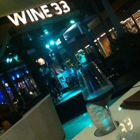 Photo taken at WINE 33 By Singha by Tori P. on 9/25/2014