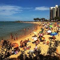 Photo taken at Praia da Costa by Gabriel L. on 7/21/2013