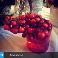 Photo taken at Floristería Brisa by Sanaz A. on 12/24/2014