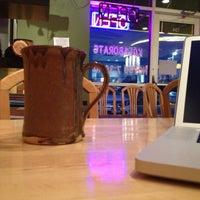 Photo taken at Artisan Coffee Bistro by Stephanie M. on 11/29/2012