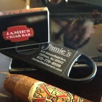 Photo taken at Jamie's Cigar Bar & Restaurant by Mike D. on 12/27/2012