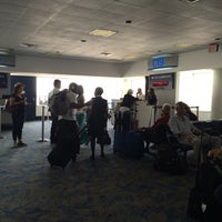 Photo taken at Gate C19 by Chris W. on 6/3/2014