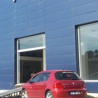 Photo taken at Ünallar Otomotiv Peugeot by Hayrettin B. on 9/30/2014