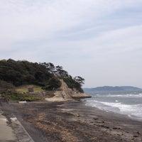 Photo taken at 稲村ヶ崎海岸 by Tomoaki M. on 4/14/2013