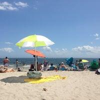 Photo taken at Ocean Parkway Beach by Steven G. on 7/4/2013