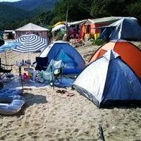 Photo taken at Totos Beach Bar by Nikos P. on 8/14/2014