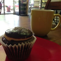Photo taken at Cupprimo Cupcakery & Coffee Spot by Chuck H. on 5/22/2013