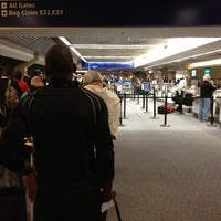 Photo taken at Terminal E by Crystal M. on 9/21/2012