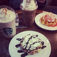 Photo taken at Starbucks Coffee by lorelei g. on 12/7/2012