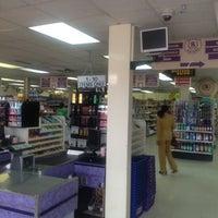 Photo taken at Penny Savers Supermarket by Keishaun J. on 6/5/2012