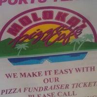 Photo taken at Molokai Pizza Cafe by Samantha L. on 3/13/2012