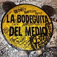 Photo taken at La Bodeguita del Medio by Bibiana O. on 8/4/2012
