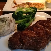Photo taken at Outback Steakhouse by Christy M. on 10/13/2012