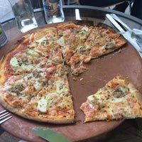 Photo taken at PizzaBella by Sebastián V. on 5/17/2014