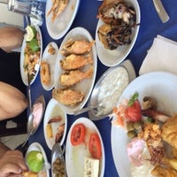 Photo taken at Zephyros Fish Tavern by Ozhan O. on 10/18/2015