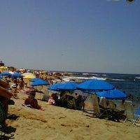 Photo taken at Bikini Beach by Camila A. on 12/30/2012