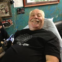 Photo taken at Saint Hillix Tattoo by Carolyn F. on 12/27/2012
