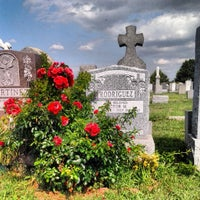 Photo taken at New Calvary Cemetery by Kris R. on 7/26/2013