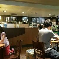 Photo taken at Starbucks by Tho on 6/4/2016