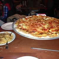 Photo taken at John's Pizzeria by Jules V. on 1/3/2013