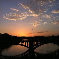 Photo taken at Pfluger Pedestrian Bridge by Aaron U. on 6/16/2013