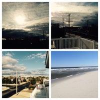 Photo taken at 83rd Street Beach by Sean R. on 4/5/2015