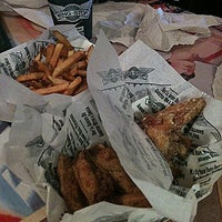 Photo taken at Wingstop by J. C. on 6/9/2013