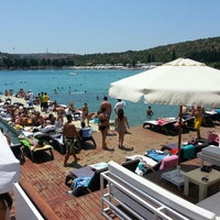 Photo taken at KafePi Beach Club by Oğulcan K. on 7/7/2013