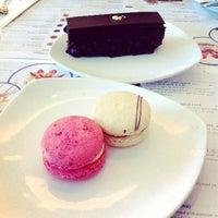 Photo taken at Canelé Pâtisserie Chocolaterie by Jocelyn G. on 6/27/2013