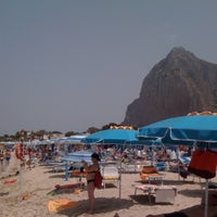 Photo taken at Spiaggia San Vito Lo Capo by Johan A. on 7/9/2012