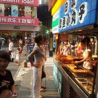 Photo taken at 东门步行街 Dongmen Pedestrian Zone by Jess G. on 6/21/2012