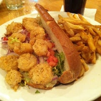 Photo taken at Olivia's Café by Anna on 3/19/2012