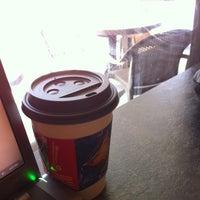 Photo taken at Coffee Groundz by Sarah G. on 4/6/2012