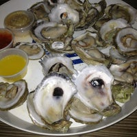 Photo taken at Norman's Raw Bar & Grill by Amanda E. on 2/21/2013