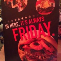 Photo taken at T.G.I. Friday's by Julia D. on 1/2/2013