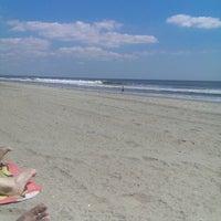 Photo taken at Rockaway Beach by Lea L. on 9/3/2014