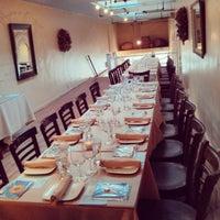 Photo taken at Mezes Kitchen & Wine Bar by Mezes Wine Bar & Greek Kitchen m. on 5/1/2013