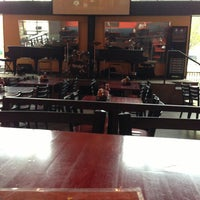Photo taken at Blue Moon Piano Bar by Megan M. on 5/10/2013