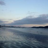 Photo taken at Praia do José Menino by Daniel B. on 4/17/2012