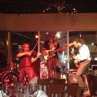 Photo taken at Acoustix Jazz Restaurant And Lounge by Denitia F. on 3/22/2013