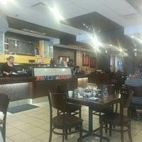 Photo taken at Casa Mia Café by Eric R. on 6/13/2014