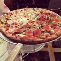 Photo taken at Panico's Brick Oven Pizzeria by Tomonori T. on 10/1/2014