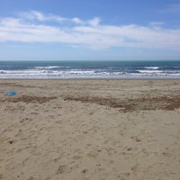 Photo taken at Lido Beach Spiaggia Libera Lido Di Camaiore by Ilaria G. on 5/1/2014