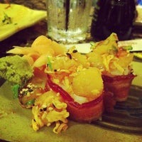 Photo taken at The Islands Sushi and Pupu Bar by Calvin C. on 8/25/2013