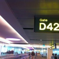 Photo taken at Gate D42 by Cedric Y. on 9/11/2013