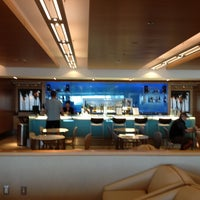 Photo taken at Delta Sky Club by Michael L. on 5/5/2012